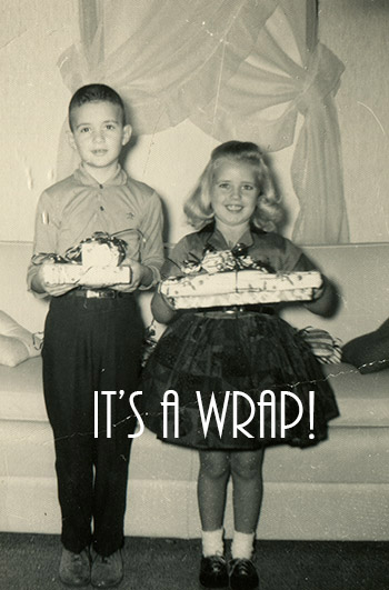 CANADA - CIRCA 1950s: Reproduction of an antique photo shows girl and boy posing with Christmas gifts in his hands
